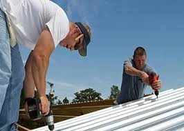 Roof Installation In Progress On A Metal Roof